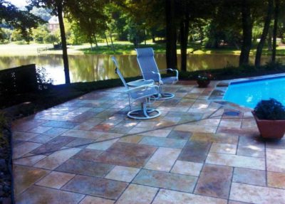 Tips for Coordinating Outdoor Concrete Colors with Poolside Landscaping